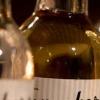 närbild på grappaflaskor